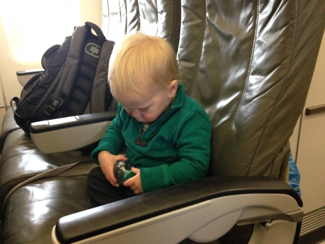 Max buckling his seatbelt on the plane.. deep breaths!
