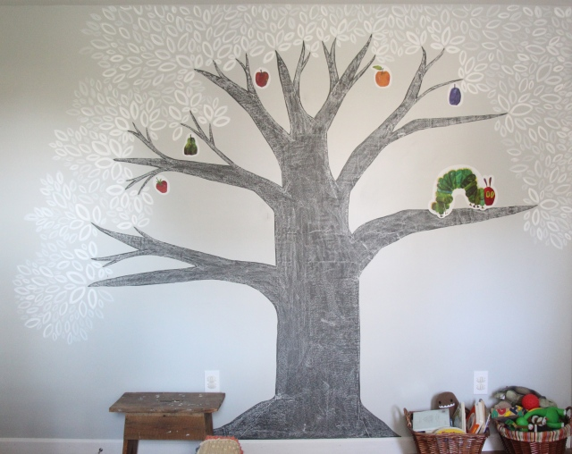 Step 11: Cure the Chalkboard Paint by rubbing the side of chalk along the entire surface of the tree. Erase it.