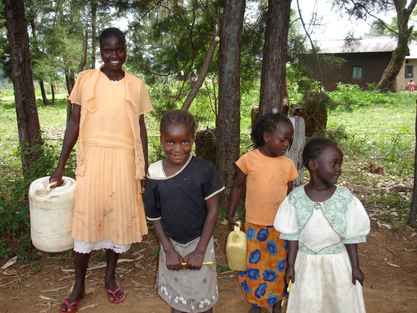 Girls collecting water at nearby spring in Namawanga, Kenya