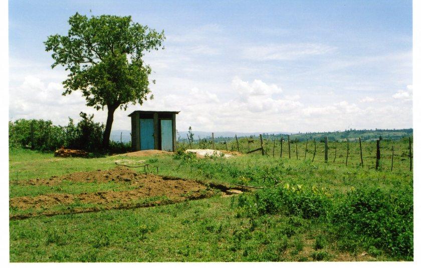 a latrine in the distance; namawanga, kenya