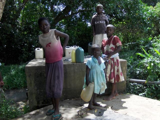 girls collect water at local spring, namawanga, kenya